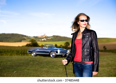 Girl with a Golf Driver and Post-War classic car