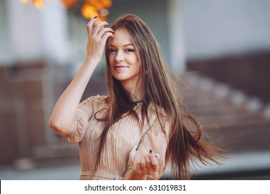 girl with gorgeous long healthy hair, street portrait