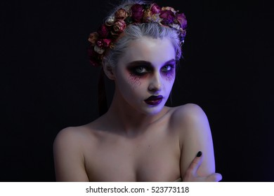 Girl in gothic art style with creative makeup,drop on her face