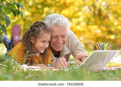 girl  and grandfather with  laptop