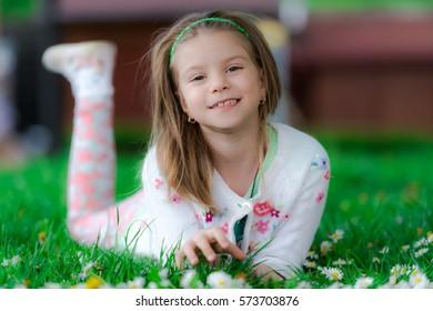 Girl in the grass field