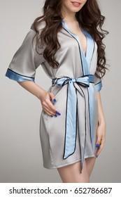 Girl in  gray silk robe, on gray background