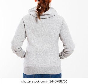 Girl in a gray sweatshirt with a hood and an empty space for a logo isolated close up