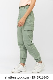 girl in green cargo pants and a t-shirt