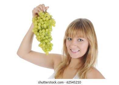 Girl with green grapes. Isolated on white background