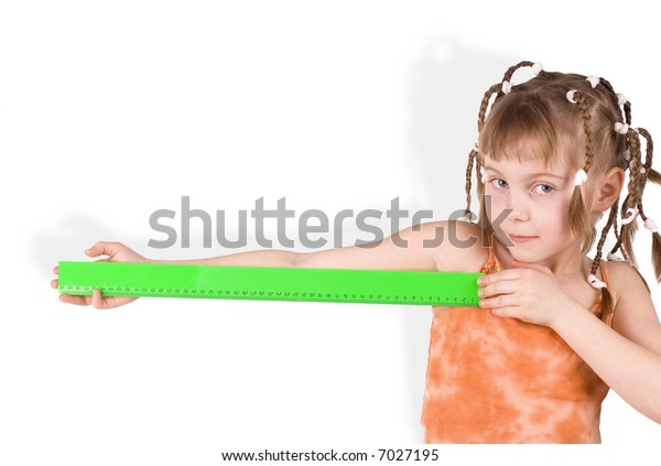 The girl with a green ruler on a white background