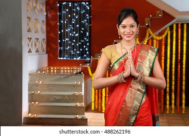 Girl greeting on Diwali festival ,Portrait of beautiful young Indian woman in traditional sari dress greeting on Diwali festival