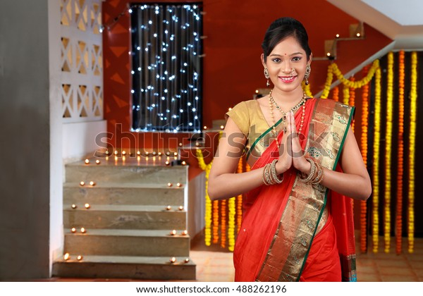 385fe09920 Girl greeting on Diwali festival ,Portrait of beautiful young Indian woman  in traditional sari dress