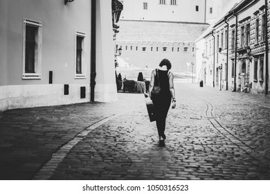Girl with the guitar on the background of the old city Cracow