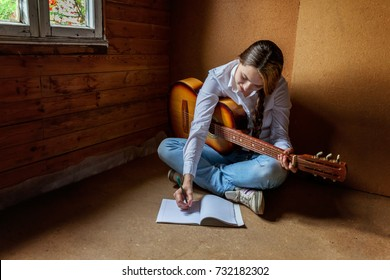 girl with a guitar who writes a song. Guitar Girl Relaxation Casual Instrument Leisure Concept