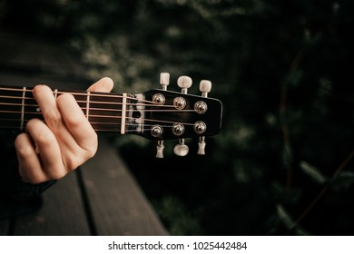 Girl with guitar in the woods