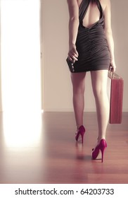 Girl with gun and briefcase walking out the door