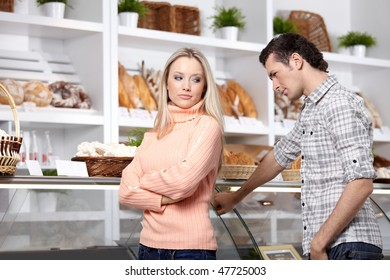 The girl and the guy in shop