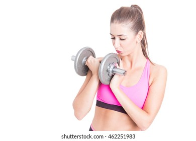 Girl at gym kissing and holding dumbbell isolated on white background with copy text area