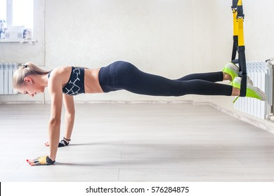 girl in a gym, planking