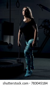 girl at the gym with a sledgehammer