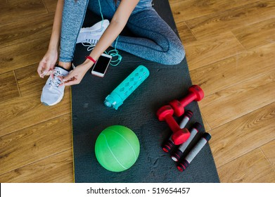 girl in a gym, sports equipment and telephone