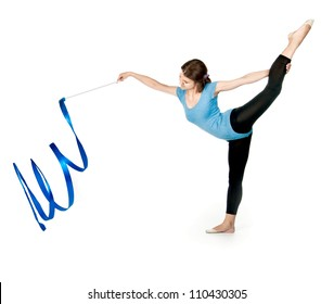 girl gymnast in blue sport suit with a ribbon