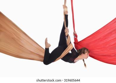 girl gymnast on aerial silk isolated on white background studio