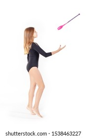 girl gymnast trains with a gymnastic clubs on white background. children's professional sports.
