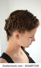 Girl with a haircut two purl French braids