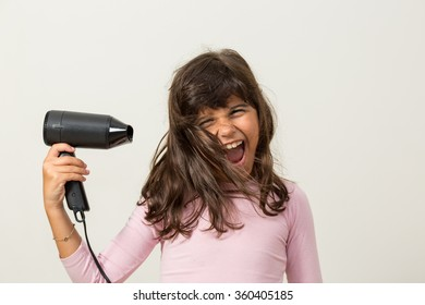 Girl with hairdryer smiling