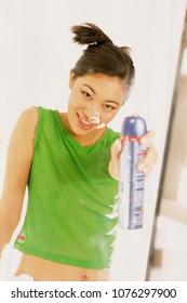 Girl with hairspray