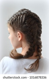 Girl with a hairstyle  two spikelets