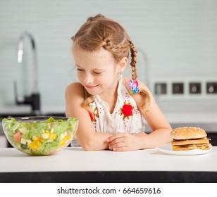 Girl with a hamburger and salad