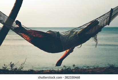 Girl in a hammock on the beach