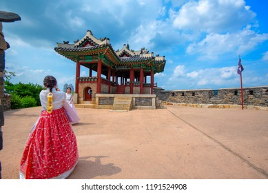 Girl with Hanbok on Hwaseong Fortress.In the beautiful sky.