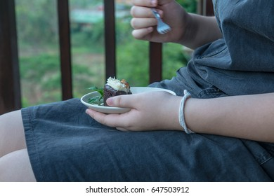 Girl hand with cake, Thailand.