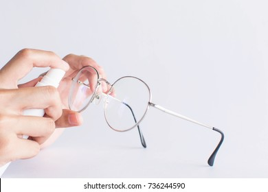 girl hand cleaning glasses lens with white background, cleaning glasses concept.