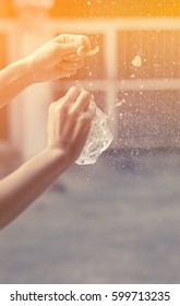 girl hand hold Water balloon explosion with splash water at outdoor with retro filter