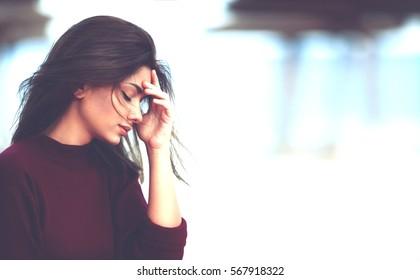 Girl With Hand on the Head. Sad Pensive Teenage Girl