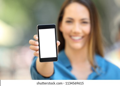 Girl hand showing a phone screen mock up on the street