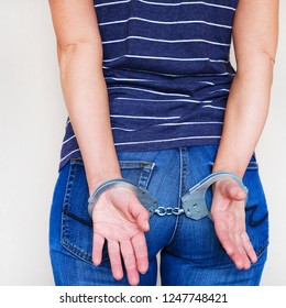 The girl in handcuffs at the police station. Arrested for misdemeanors