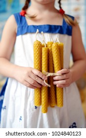A girl with hand-made beeswax candles