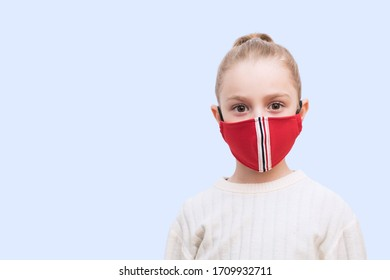 Girl with handmade mask to protect her from Corona virus. Corona virus pandemic.