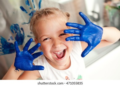 girl hands smeared with paint