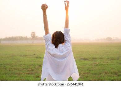Girl happiness with beautiful field in the morning