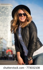 Girl happy smile in black hat, sunglasses, leather jacket in paris, france on urban environment. Lifestyle, vacation, travelling. Fashion, style, beauty concept