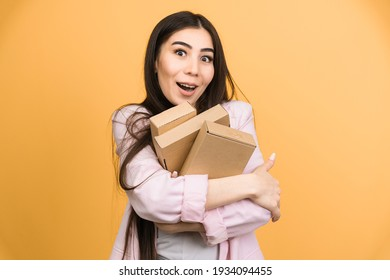 The girl is happy that she received the package