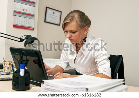 Girl hard works at office