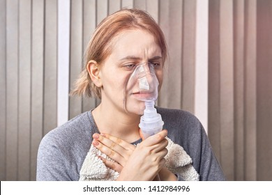 Girl has an asthma attack and uses nebulizer mask, which is uses in the treatment of respiratory diseases to stop the attack.