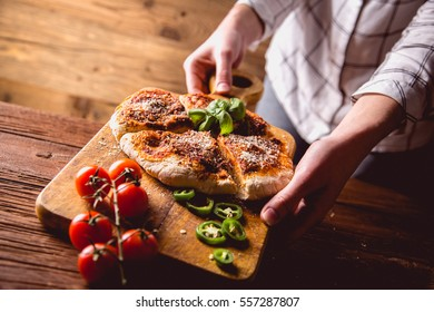 Girl has fresh homemade pizza bread ready to eat