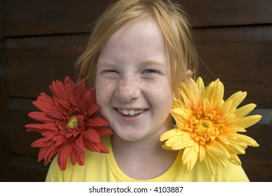 girl has fun with flowers and freckles