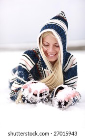 Girl has fun with snow in cold winter time