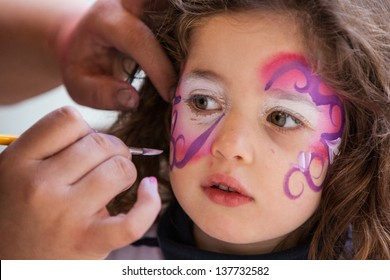 A girl has her face painted in California, USA