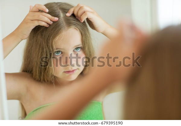 The girl has a problem with her hair